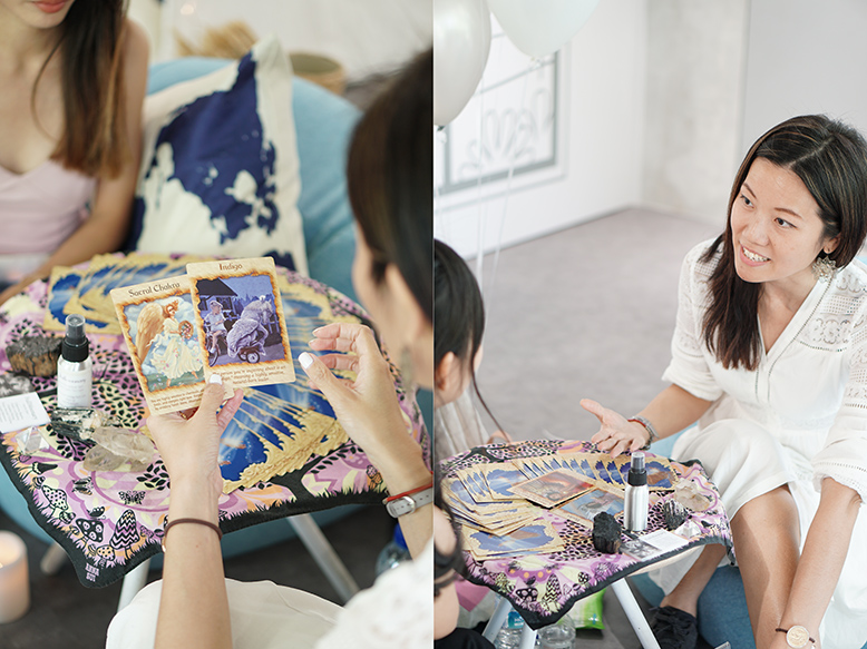 Photos of two girls doing tarot reading