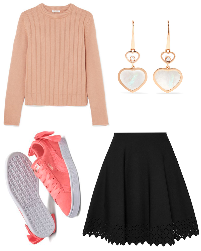 A pink ribbed cashmere sweater, a black laser cut knitted mini skirt, a pair of pink suede bow sneakers, and a pair of 18-karat rose gold heart earrings