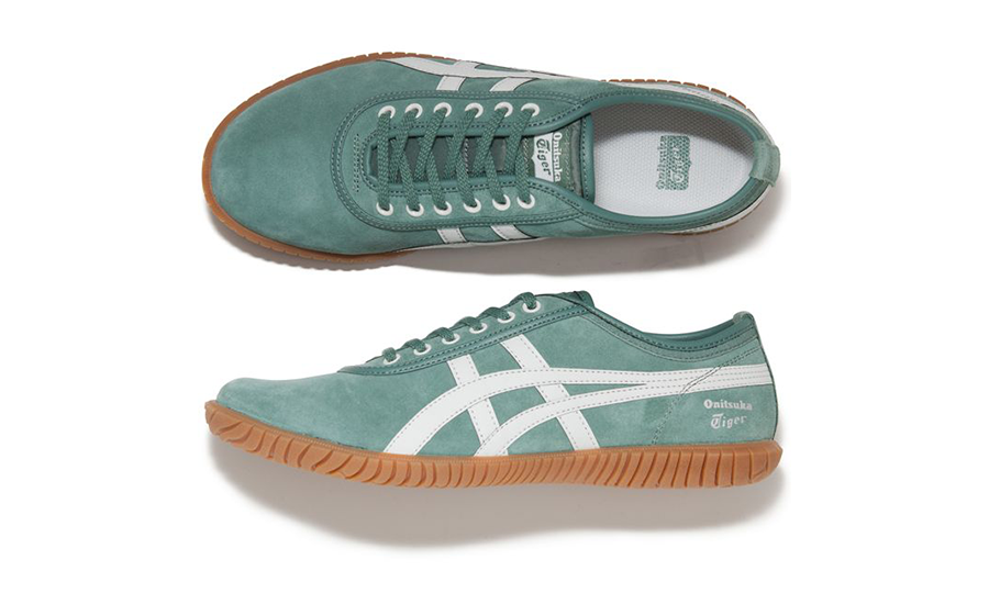 A vintage-looking green suede sneakers with Onitsuka Tiger's white logo across its sides.