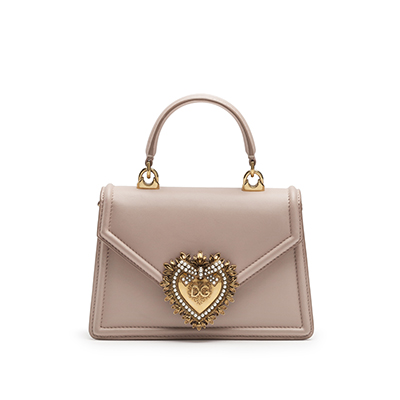 A beige handbag with a huge heart design