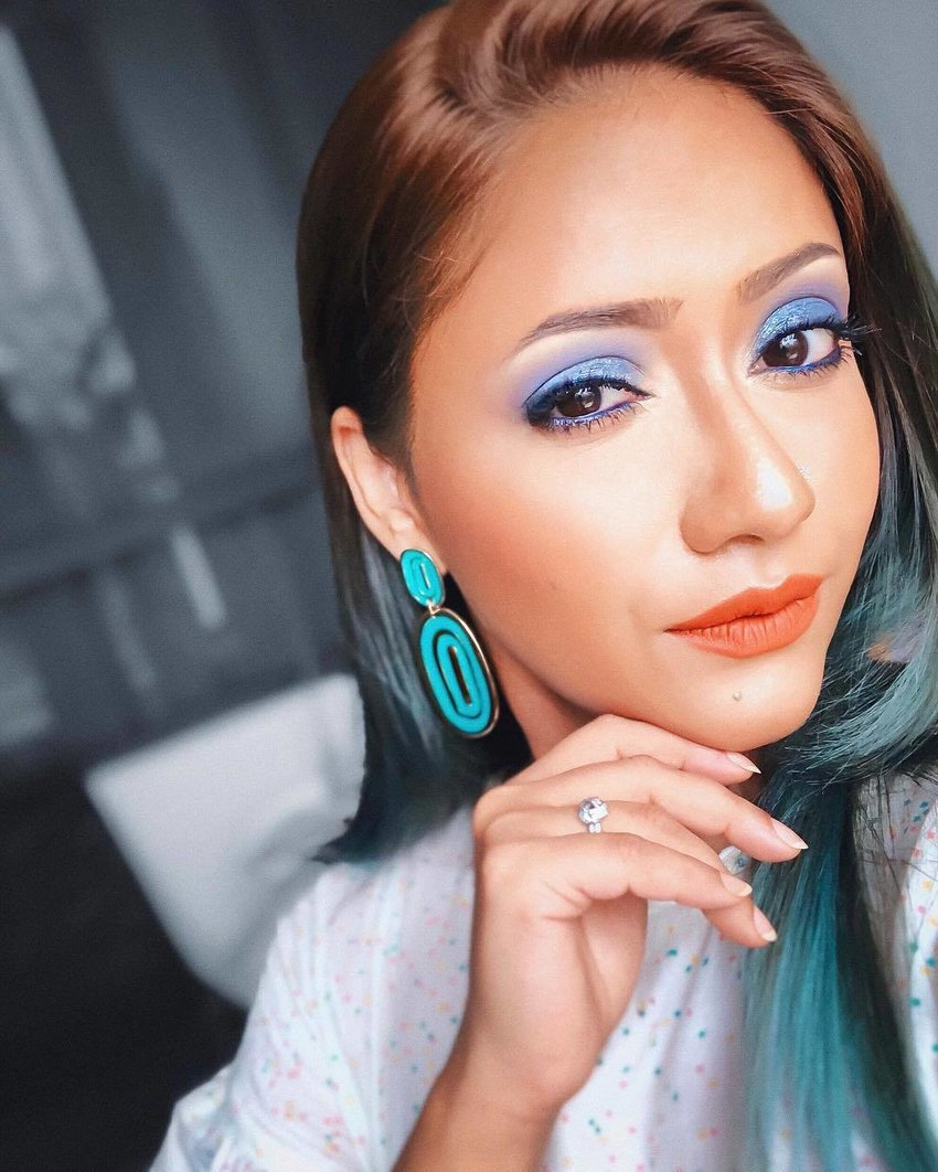 Woman with shimmery blue eyeshadow