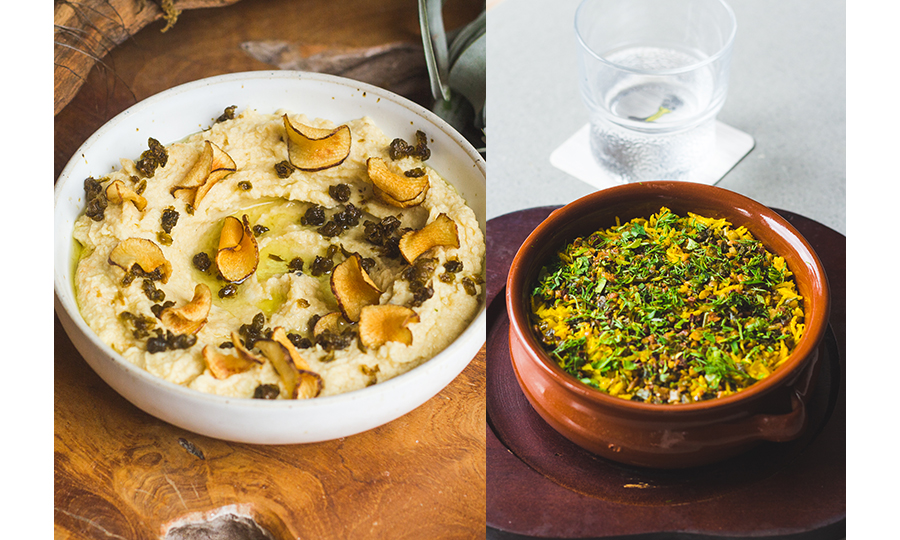 A bowl of a mashed hummus-like dish, and a bowl of greens