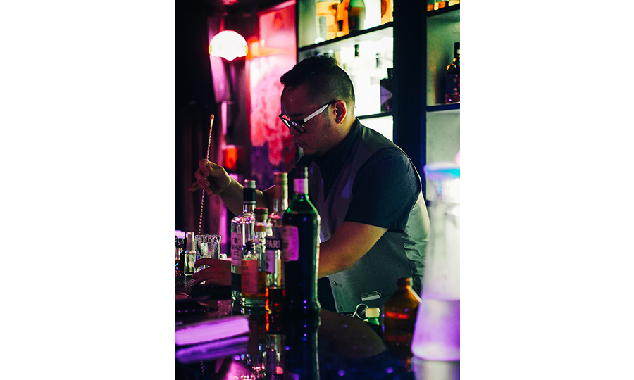 A bartender mixing cocktails