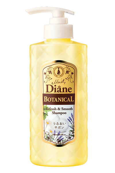 A white-capped push bottle with vintage-styled labeling, filled with honey coloured shampoo.