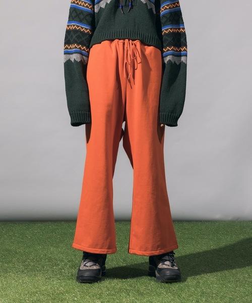 Woman in Orange Sweat Pants