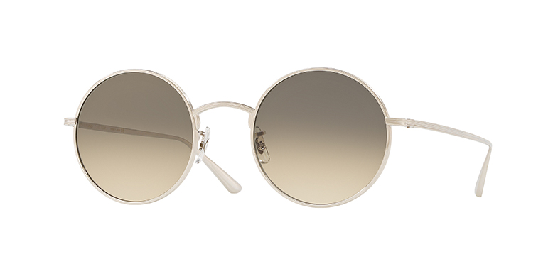 A round '80s inspired sunglass with a titanium frame detailed with linear engraving.