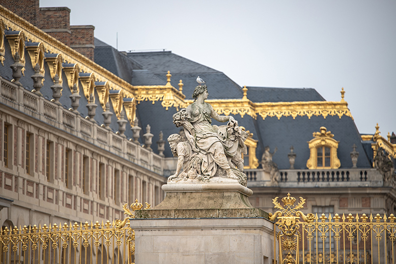 A statue outside the Palace of Versailles