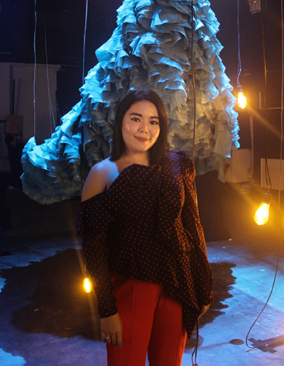 Filipino fashion designer Sassa Jimenez posing for the camera during her 10th anniversary collection launch