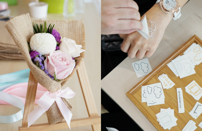 On the left is a photo of a tiny floral bouquet; On the right is a photo of someone applying a temporary tattoo of clouds on her hand, plus a wooden plate full of other tattoos.