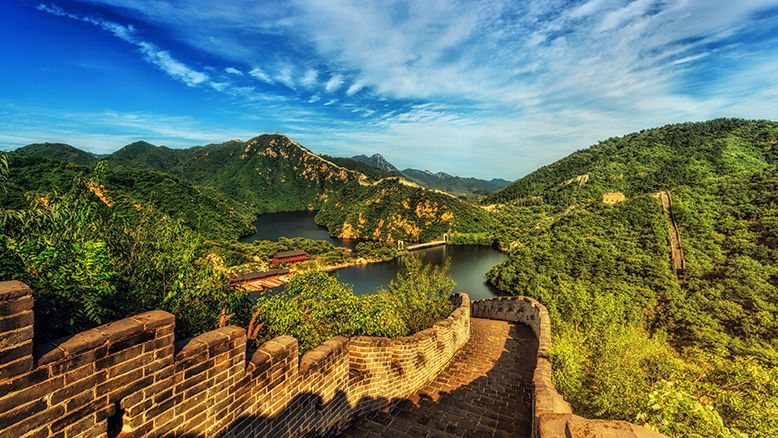 The Great Wall of China spanning miles across lush greenery