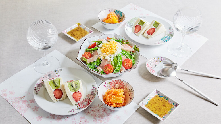 Dining table with vegetables and dessert