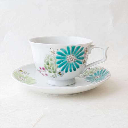 Cup and saucer with flower